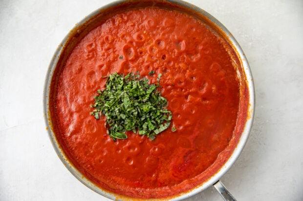 Tomatoes and basil in large saucepan