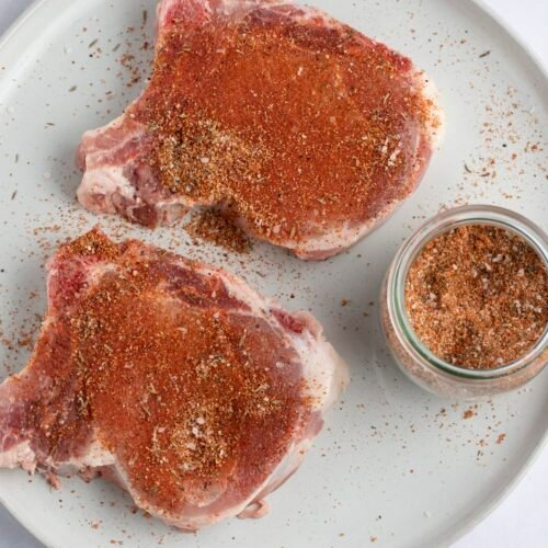 Pork chop seasoning on raw pork chops