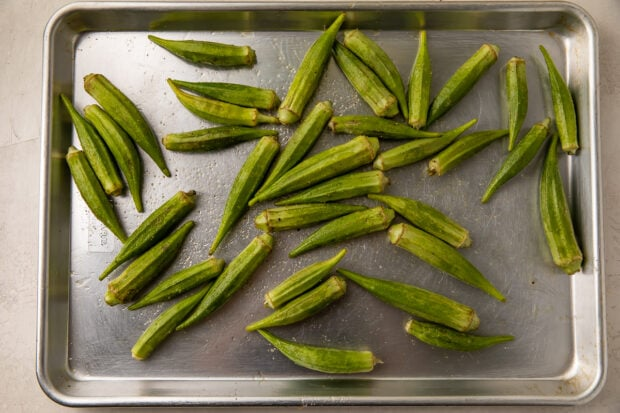Raw fresh okra on baking sheet