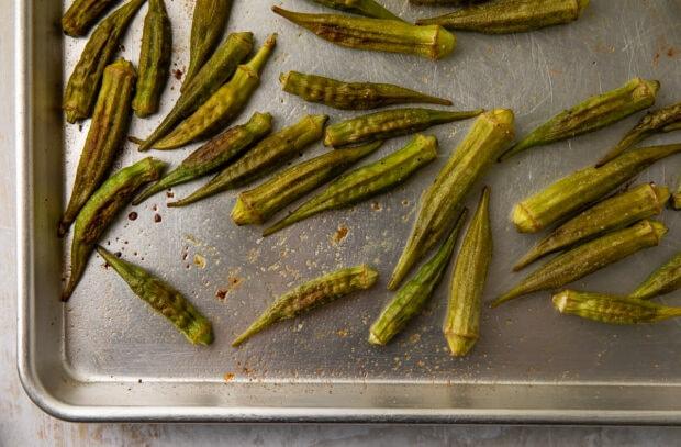 Roasted okra on baking sheet