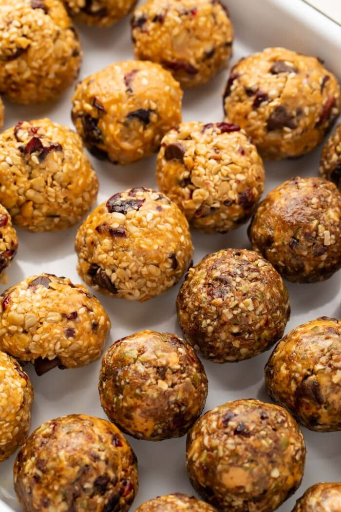 Rows of seed cycling balls on parchment paper