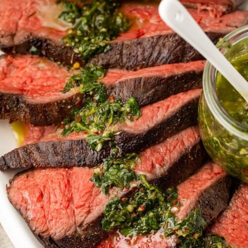 Sous vide tri tip close up with chimichurri sauce
