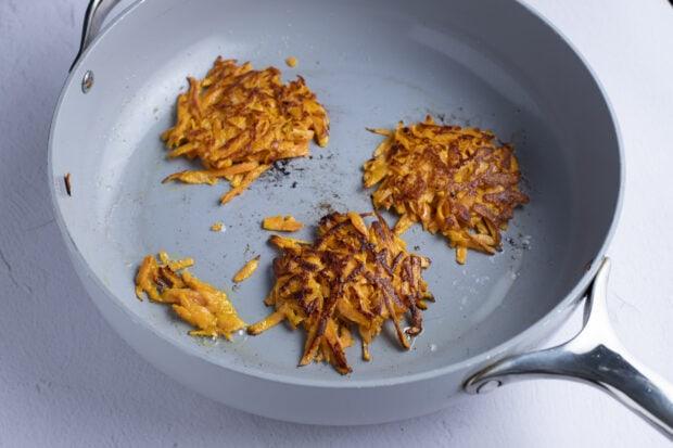 Sweet potato hash browns in large skillet