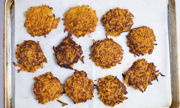 Sweet potato hash browns on baking sheet lined with parchment paper