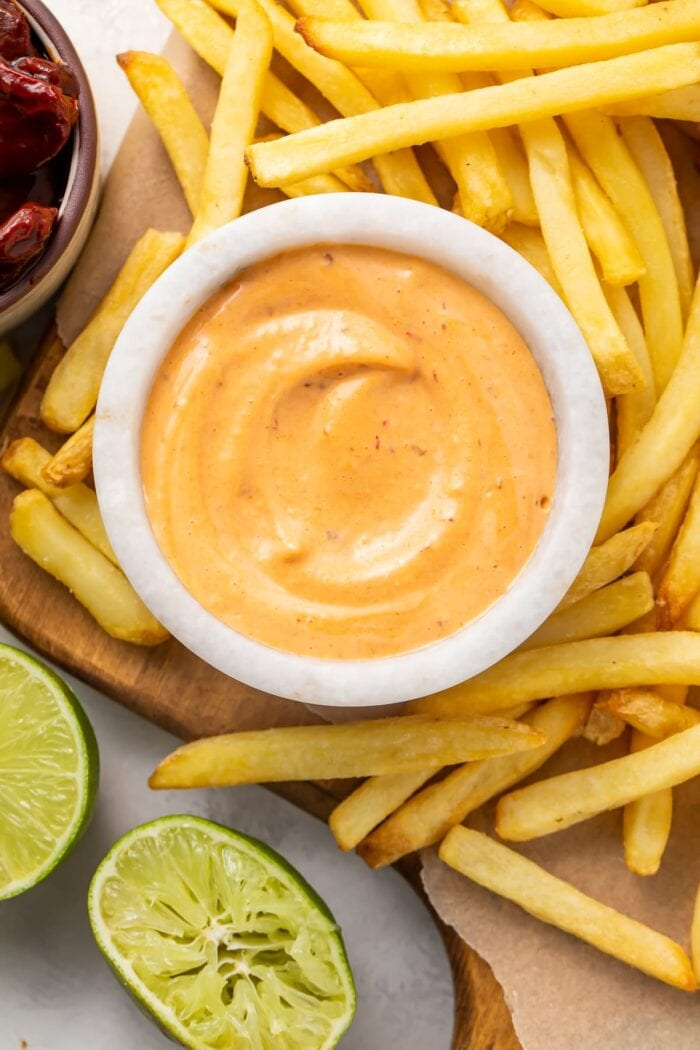 French fries surrounding a small bowl of chipotle mayo
