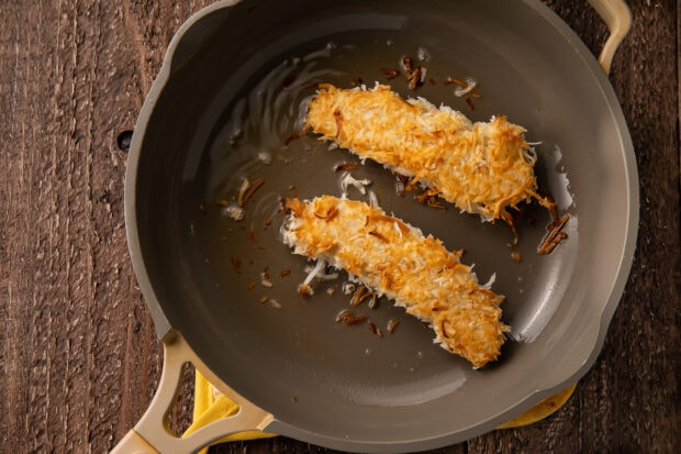 Fried chicken strips in large skillet