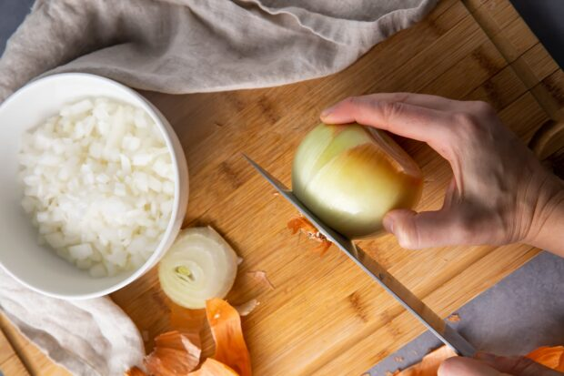 Slice the ends off the onion with a sharp knife