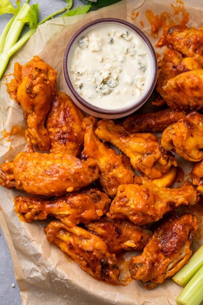 A plate of Instant Pot chicken wings with ranch dressing
