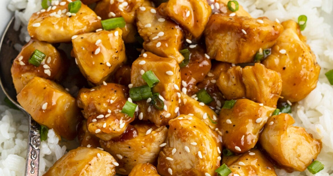 Mandarin chicken with rice in large bowl