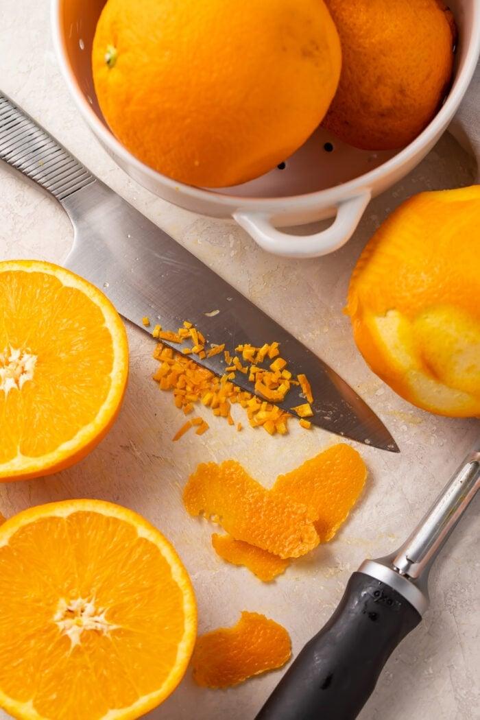 Oranges, orange zest, and a knife