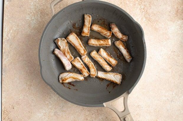 Pork strips in large skillet