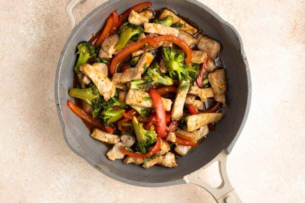 Pork stir fry in large skillet