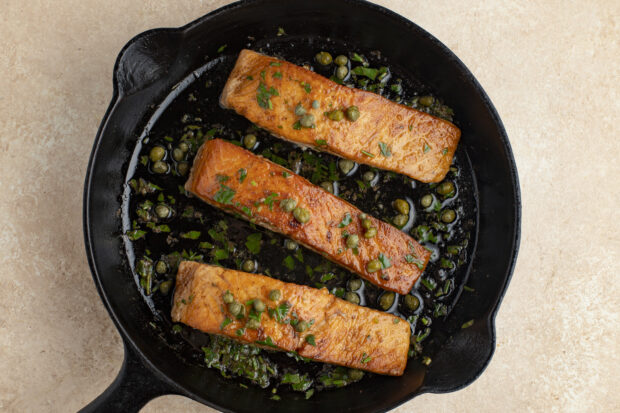 Salmon meuniere with capers in cast iron skillet