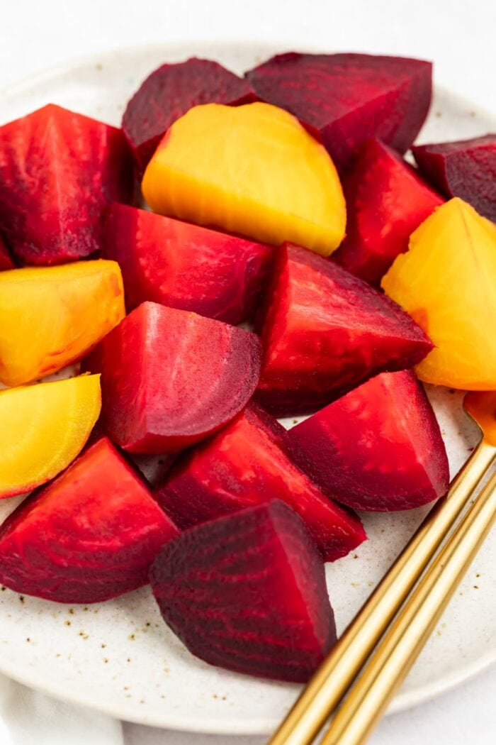 sliced red and golden beets on a plate
