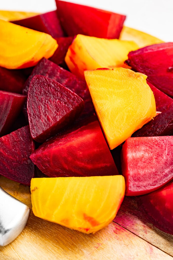 sliced red and golden beets on a cutting board