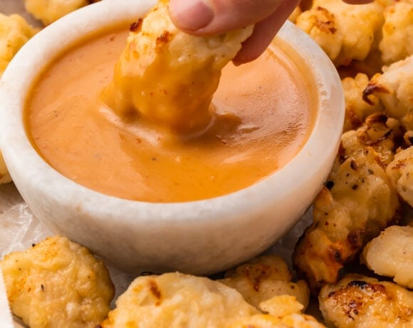 An air fryer chicken nugget dipped into copycat Chick-fil-a sauce
