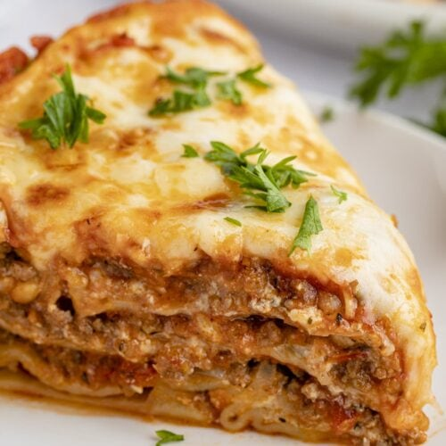 Close up view of a slice of Instant Pot lasagna on a white plate