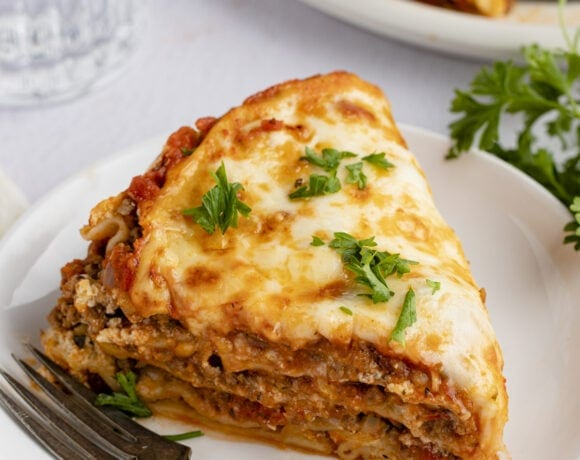 A wedge slice of Instant Pot lasagna on a white plate