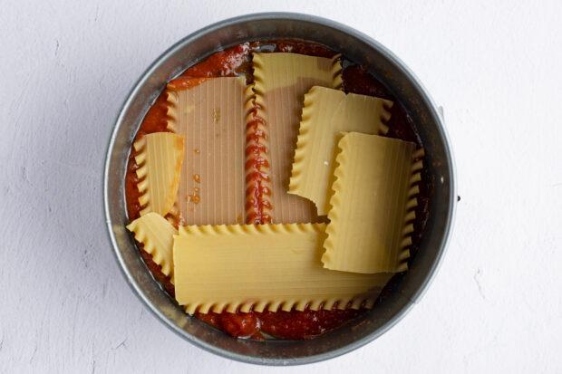 Bottom layer of lasagna in springform pan
