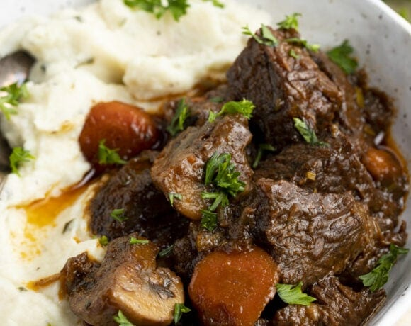 Keto beef stew with mashed cauliflower in a large bowl