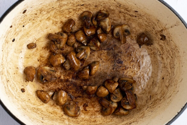 Mushrooms and oil in dutch oven.