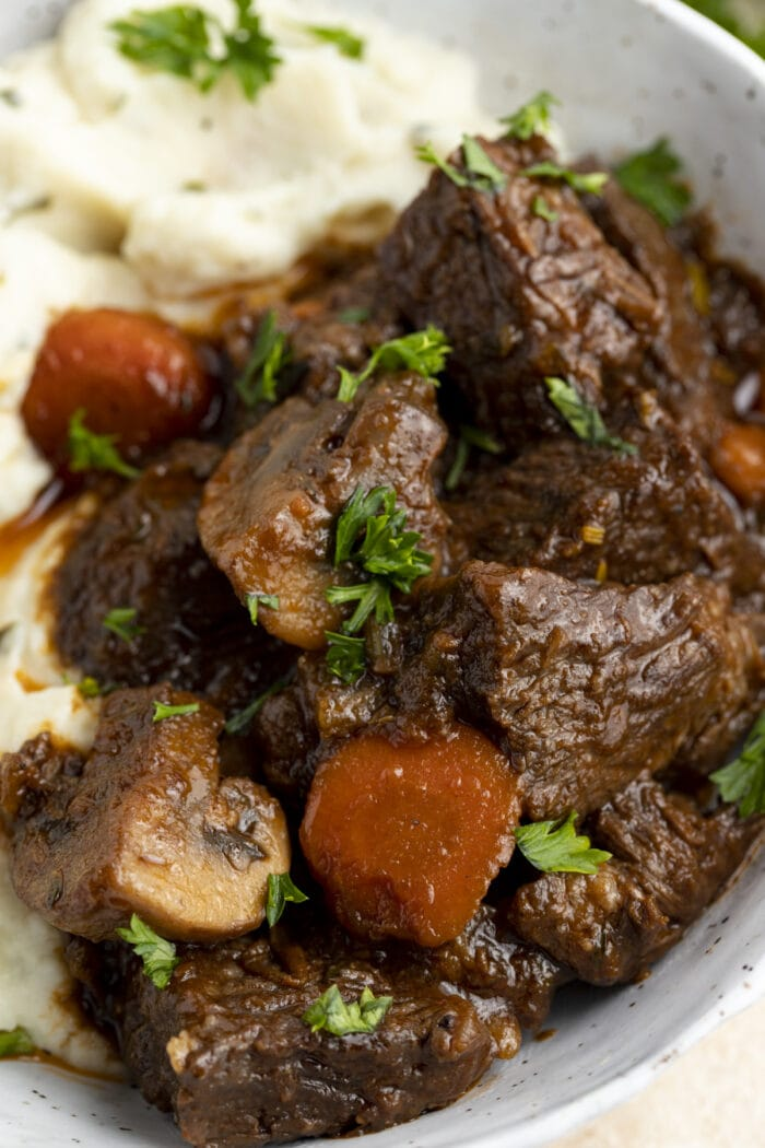 Close-up of keto beef stew and mashed cauliflower in a large bowl