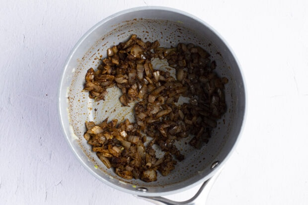 Spices and onion in saucepan