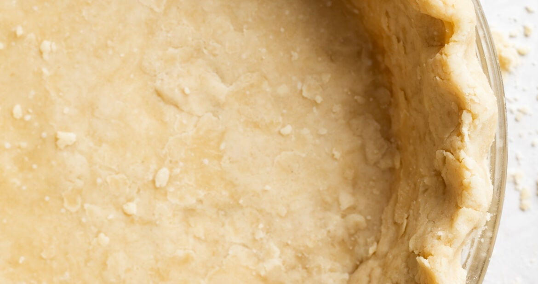 overhead image of vegan pie crust in a pie dish