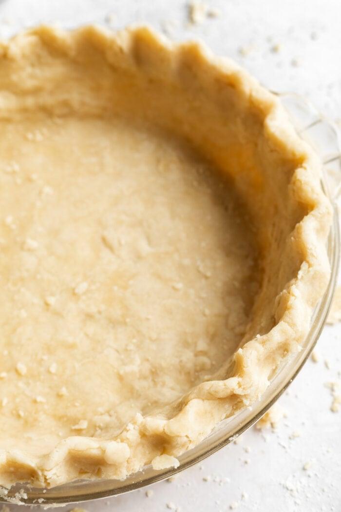 close up image of vegan pie crust in a pie dish