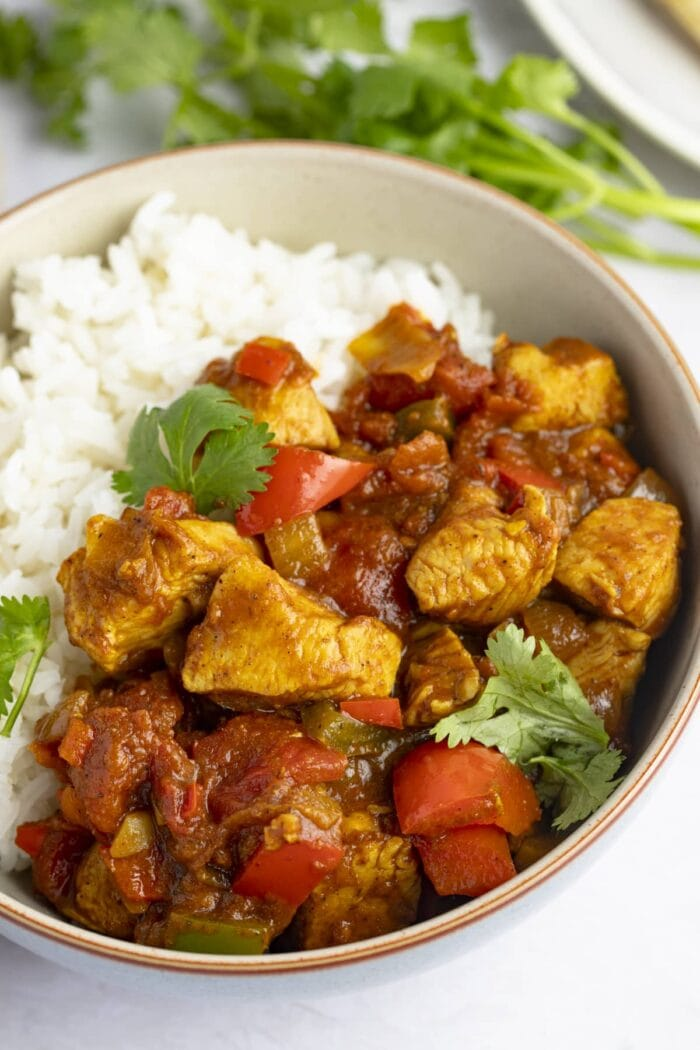 Chicken jalfrezi in a bowl with white rice