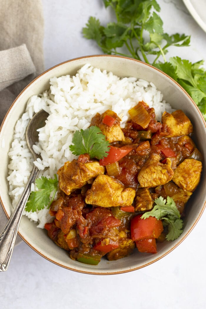 Overhead view of chicken jalfrezi in a bowl with white rice
