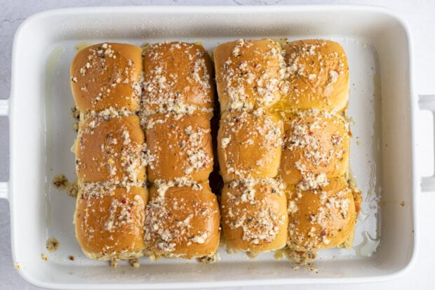 Unbaked chicken parm sliders in baking dish