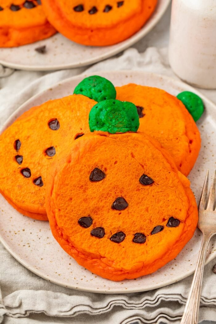 Super cute and easy jack o lantern pancakes on a plate