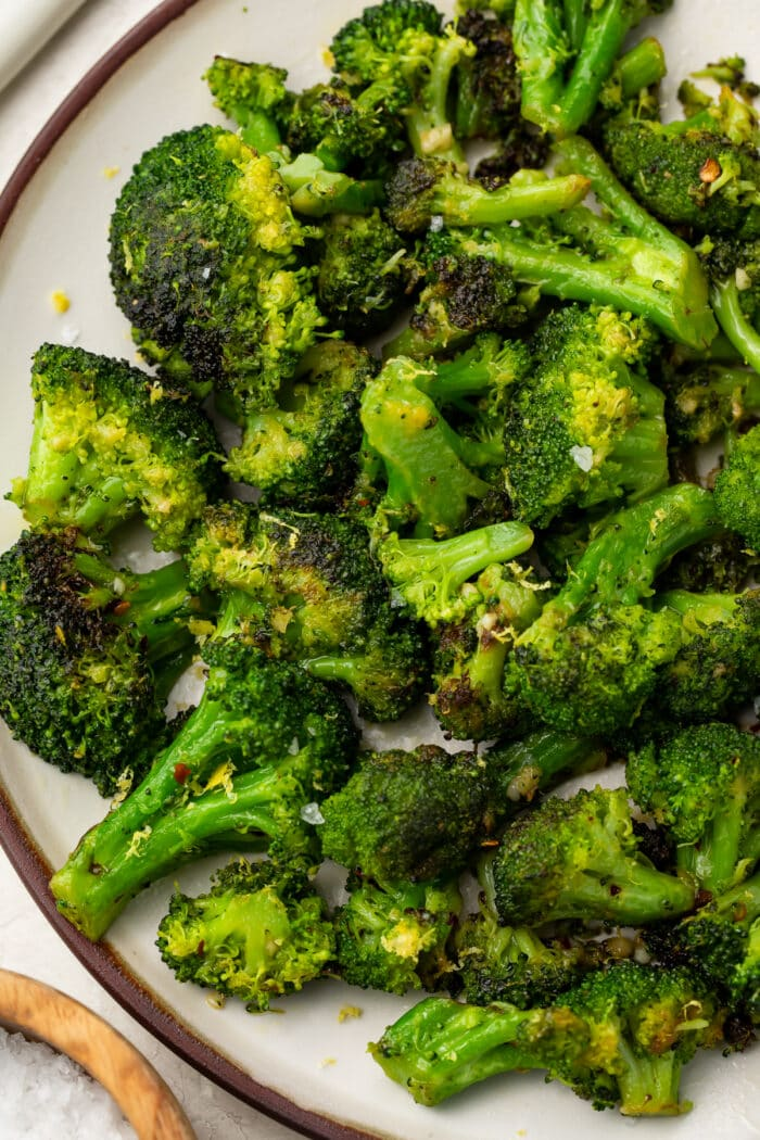 Sauteed broccoli on a white plate